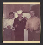 Denis Mailhot in Uniform Standing with Two Men in Kitchen