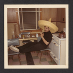 Denis Mailhot Seated and Wearing a Sombrero