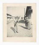Elisée A. Dutil Posing with Rifle