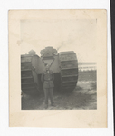 Elisée A. Dutil Posing in Front of Tank