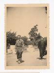 Elisée A. Dutil Walking near Woman with Bag