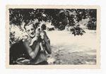 Elisée A. Dutil Holding a Puppy