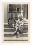Woman Sitting on Steps with Photograph of Elisée A. Dutil