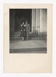 Elisée A. Dutil Standing with Woman in Building Entrance