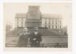 Elisée A. Dutil Posing in Front of Monument with Man in Suit