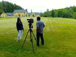 Photo of Tim Goff interviewing Lisa Walker in front of Maine Chance Farm by Jeanne Curran-Sarto