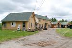 The Maine Chance Farm Renovation - Back of Main House by Marina Douglas