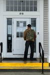 South Portland: A Man at the Locked Front Door of City Hall by Jim Neuger